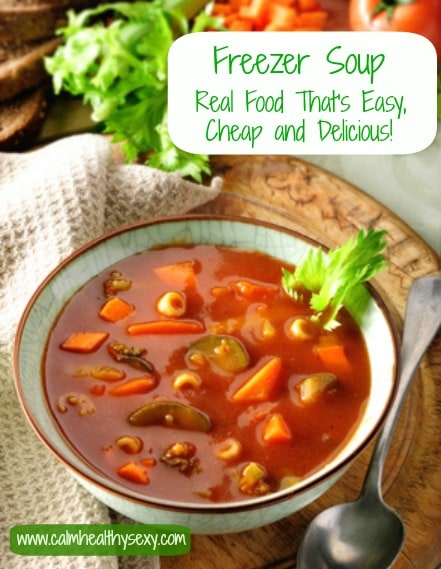 Vegetable and tomato soup. Rustic setting with ingredients in the background.